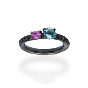 d'Avossa Ring in 18Kt black gold with pavé of black diamonds, central round-cut Blue Topaz and Purple Sapphire. (5)