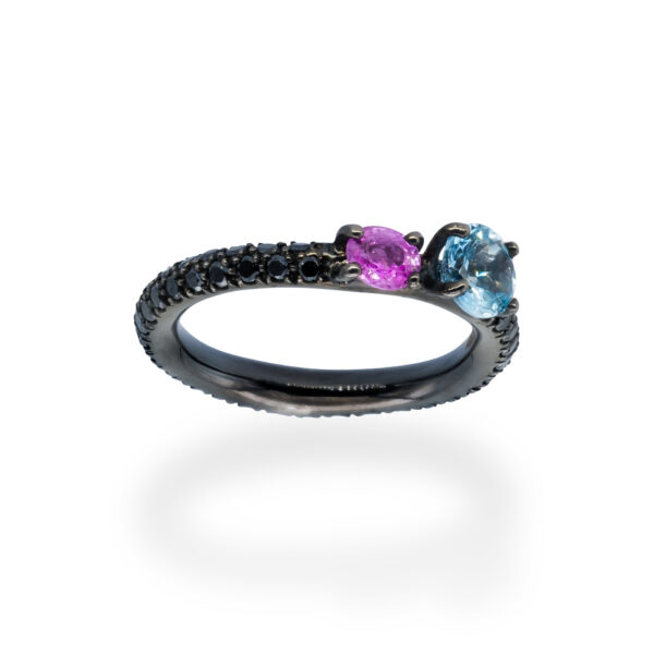 d'Avossa Ring in 18Kt black gold with pavé of black diamonds, central round-cut Blue Topaz and Purple Sapphire. (4)
