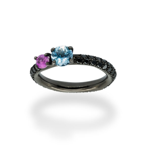 d'Avossa Ring in 18Kt black gold with pavé of black diamonds, central round-cut Blue Topaz and Purple Sapphire. (3)