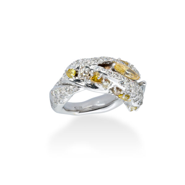 d'Avossa Ring in 18kt white gold with two central Diamonds marquise cut, Fancy yellow and White, on a pavé of white diamonds and two rows of Fancy Yellow diamonds. (5)